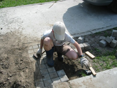 Sashko is busy at work with his sidewalk job