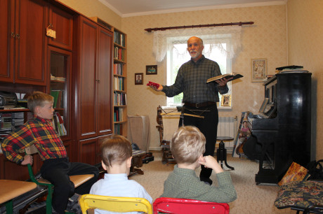 Grandpa preaching at family devotions