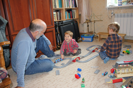 All boys like to play with trains.