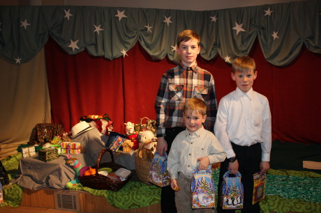 Three older boys at the children's Christmas program.