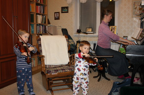 Aspiring violinists: cute to watch, but hard to listen to... yet.