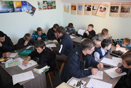 Sashko and Yurko's class: 18 boys cramped into a tiny SS classroom at the local Baptist church (Sashko in the foreground in glasses and Yurko center back reading over his test).