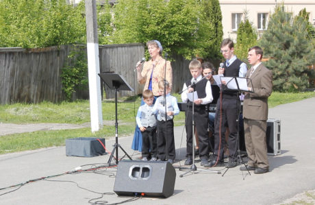 Singing at the village evangelism