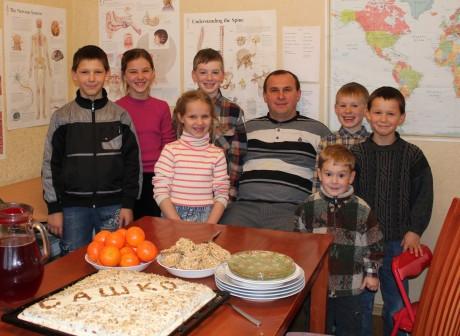 Uncle Sasha and cousins visiting for Sashko's birthday
