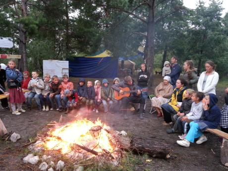 Singing around the campfire at summer camp
