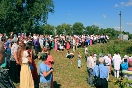 People gathered on the bank for the baptism service. This is a typical way baptisms are conducted in Ukraine.